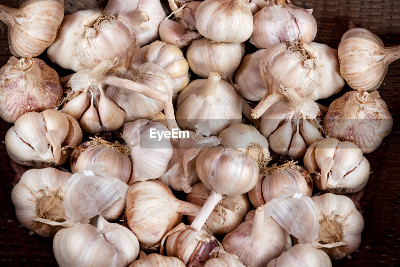 garlic, ingredient, food, food and drink, spice, freshness, wellbeing, garlic bulb, healthy eating, vegetable, raw food, close-up, no people, market, abundance, large group of objects, white color, still life, retail, indoors, garlic clove