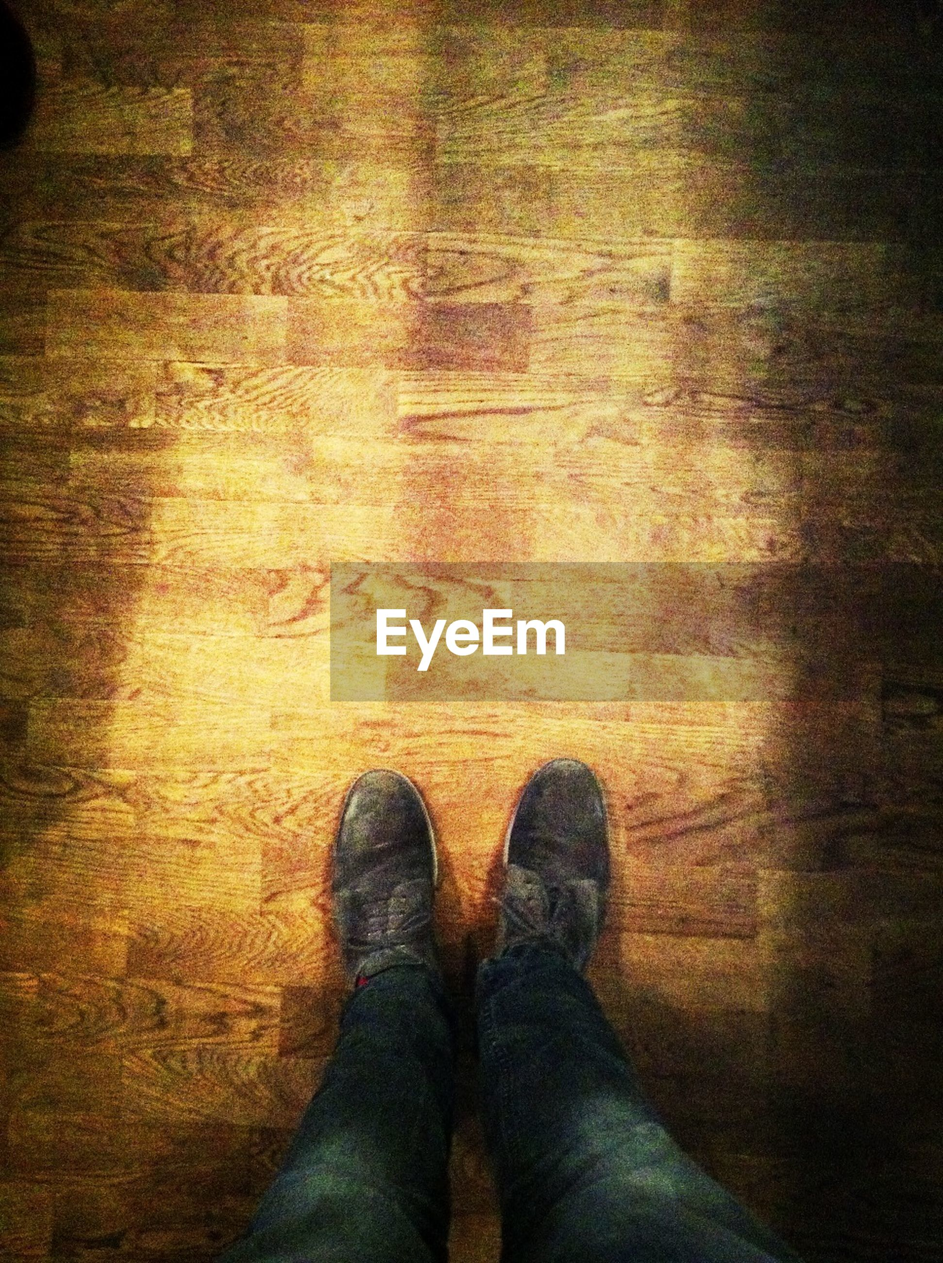 Directly above shot of man standing on wooden floor