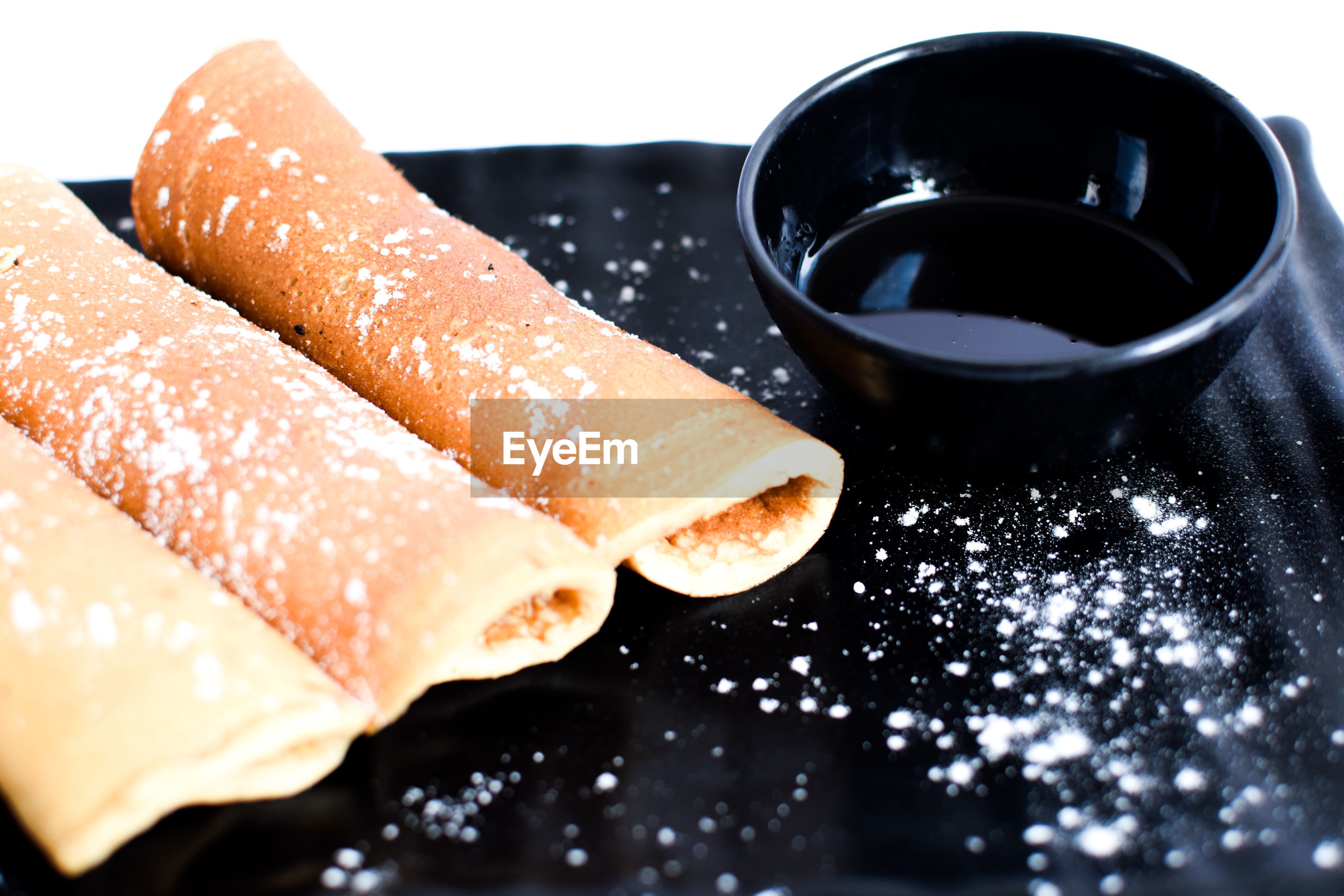 Close-up of rolled crepe against white background