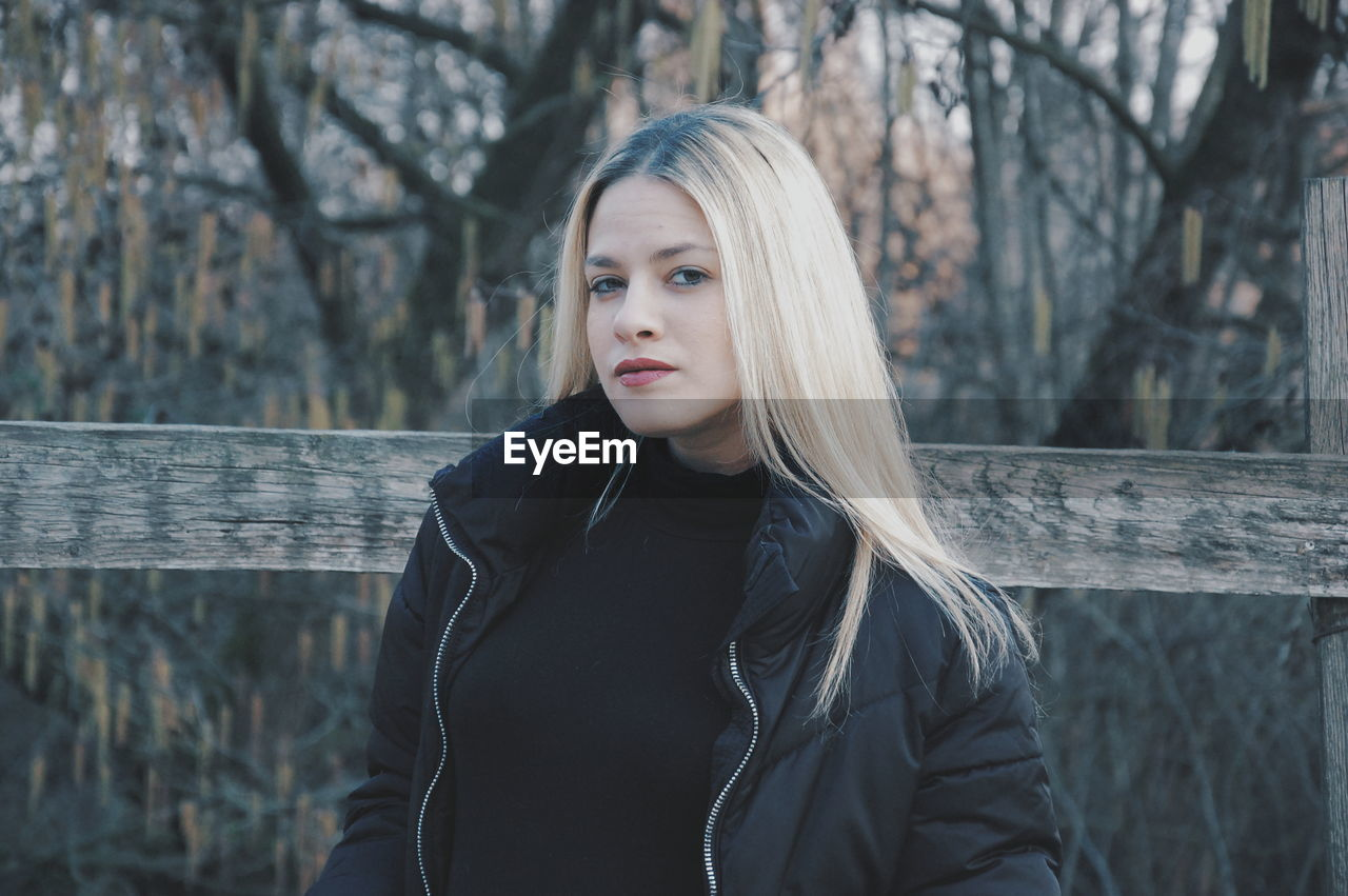 Portrait Of Beautiful Young Woman Standing In Forest