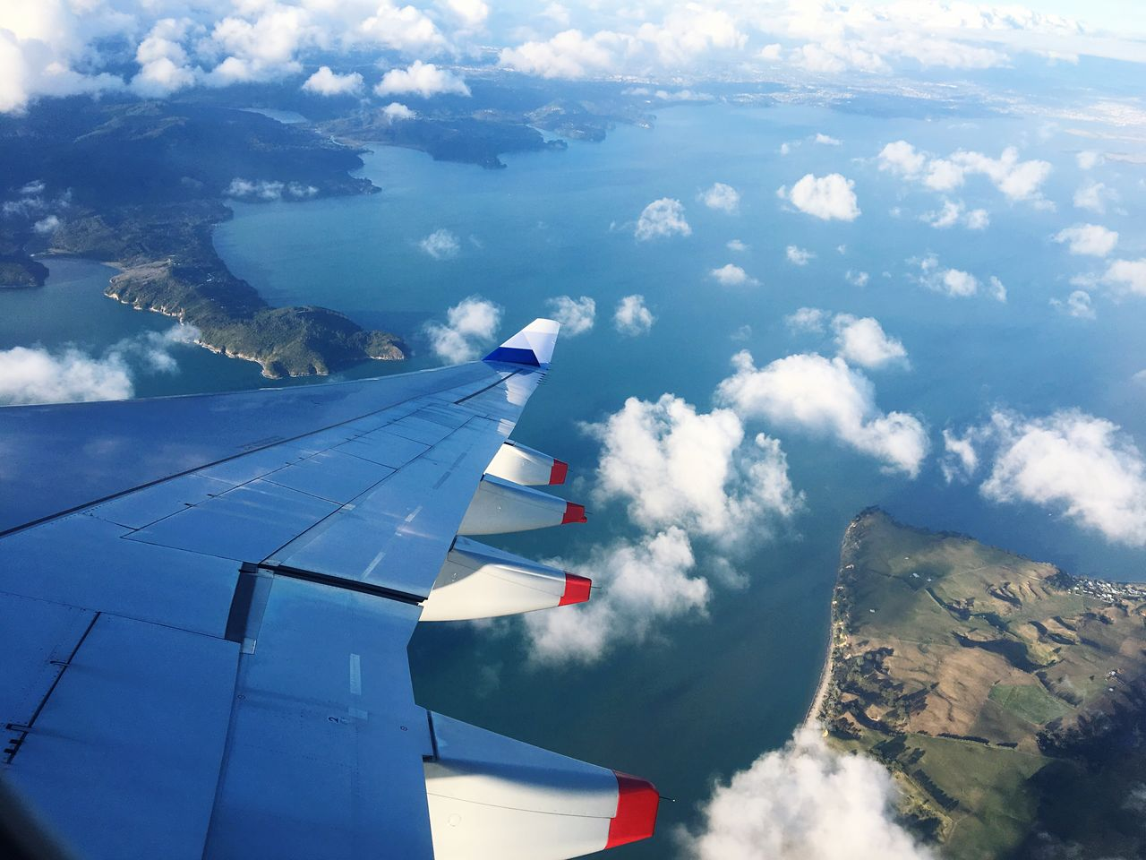 cloud - sky, airplane, sky, blue, day, nature, no people, transportation, outdoors, flying, beauty in nature, mid-air, airplane wing, air vehicle, scenics