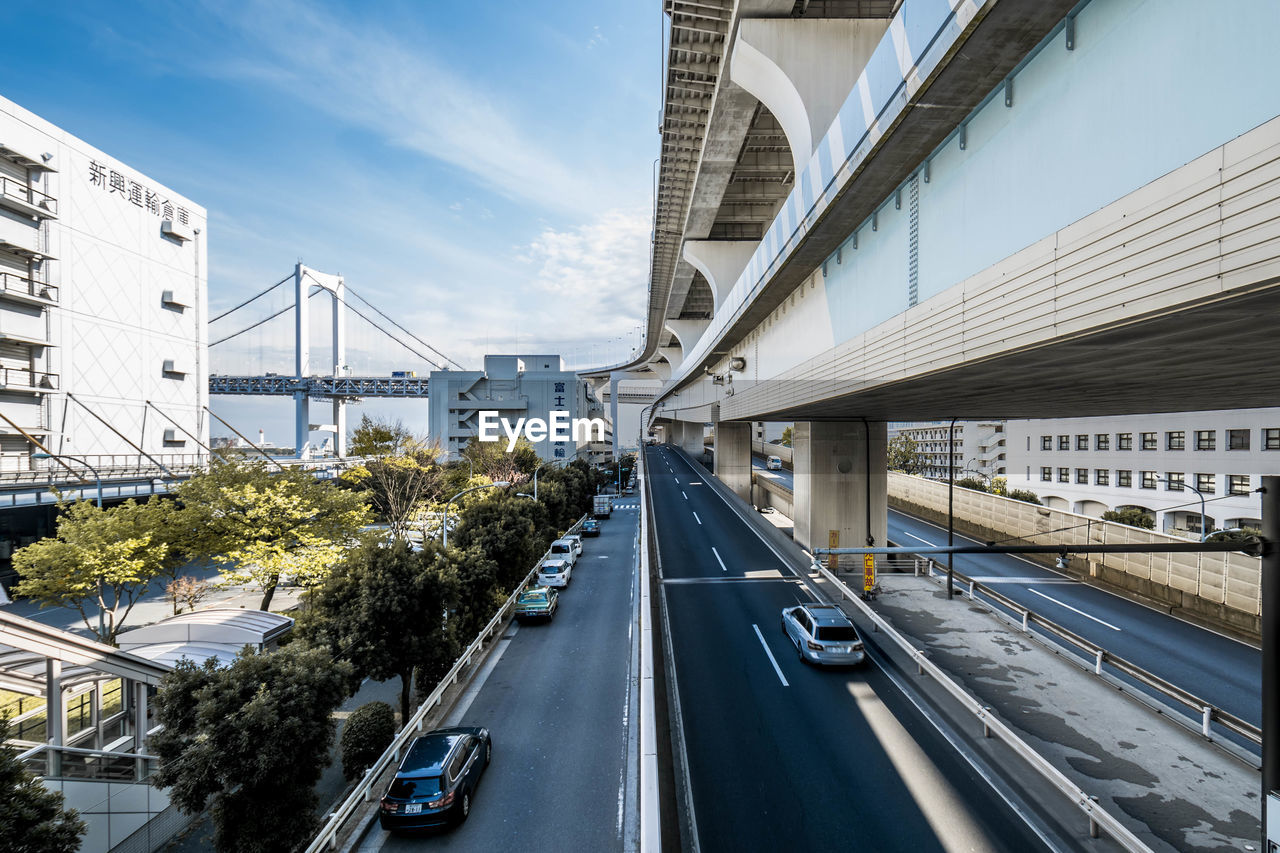 transportation, architecture, built structure, road, car, bridge, motor vehicle, city, bridge - man made structure, connection, mode of transportation, sky, building exterior, the way forward, direction, cloud - sky, land vehicle, nature, day, no people, outdoors, diminishing perspective, dividing line
