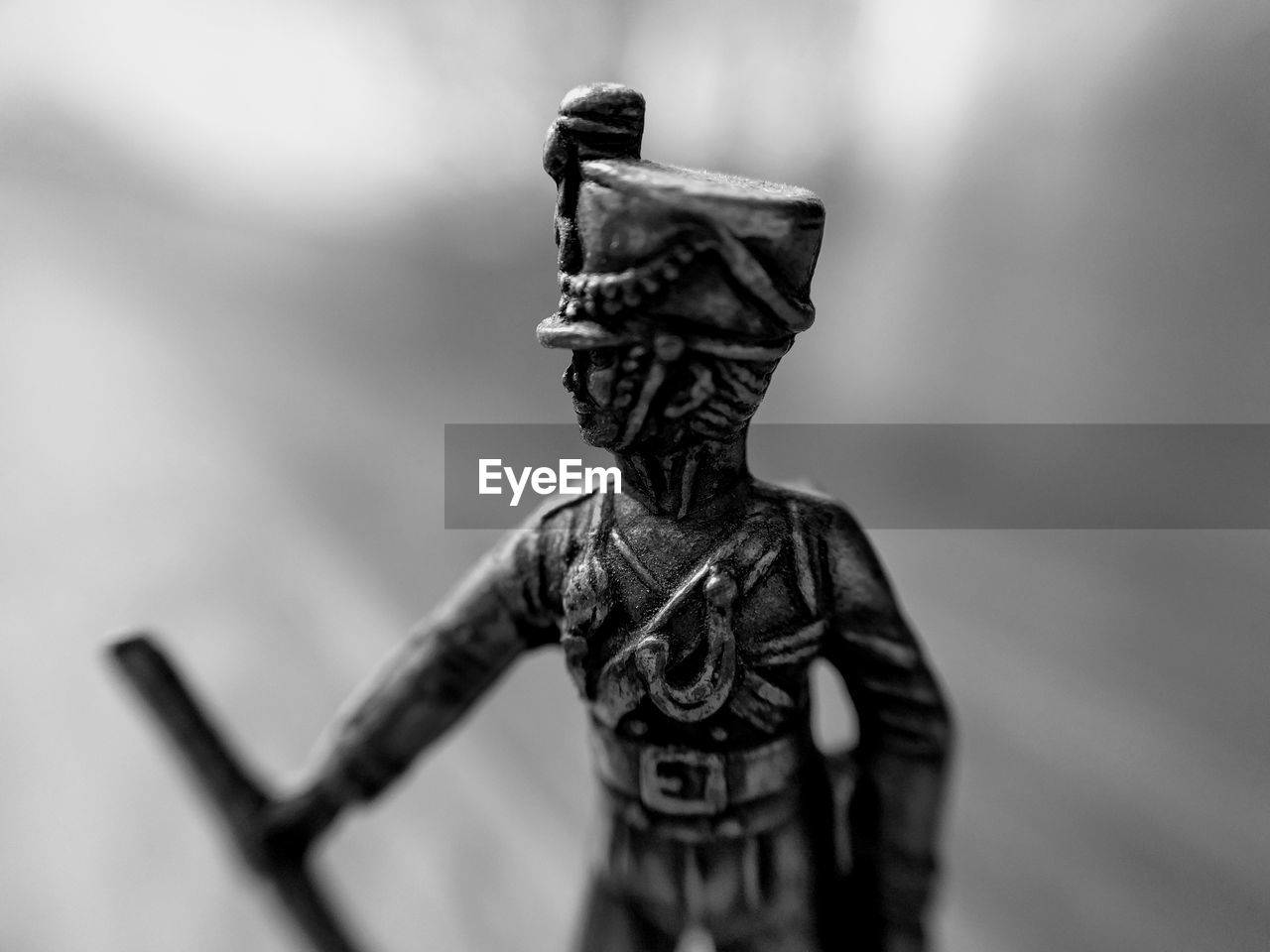 male likeness, statue, human representation, sculpture, no people, focus on foreground, military, army, weapon, day, close-up, outdoors