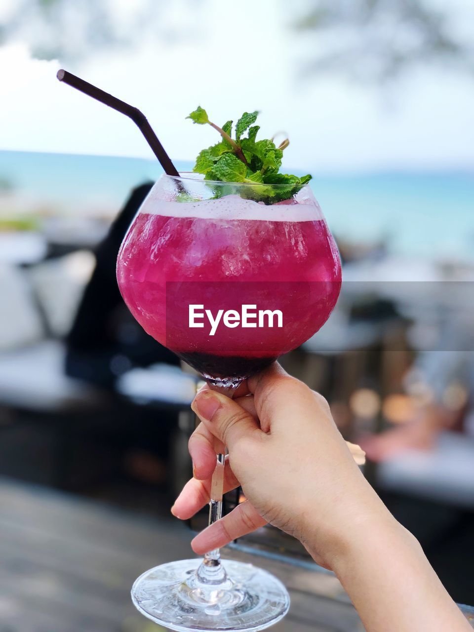 food and drink, food, holding, hand, one person, human hand, freshness, focus on foreground, human body part, real people, fruit, healthy eating, unrecognizable person, indulgence, lifestyles, day, close-up, red, berry fruit, temptation, glass, mint leaf - culinary, herb