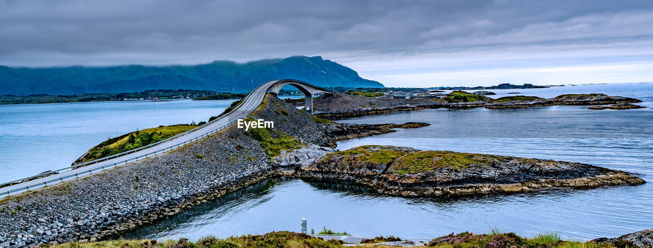 water, sky, cloud - sky, scenics - nature, nature, beauty in nature, tranquil scene, tranquility, sea, no people, day, idyllic, rock, beach, built structure, solid, connection, rock - object, non-urban scene