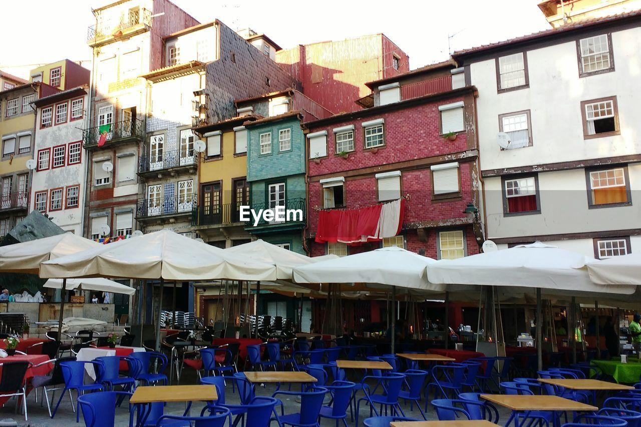 Outdoors restaurant against buildings in town
