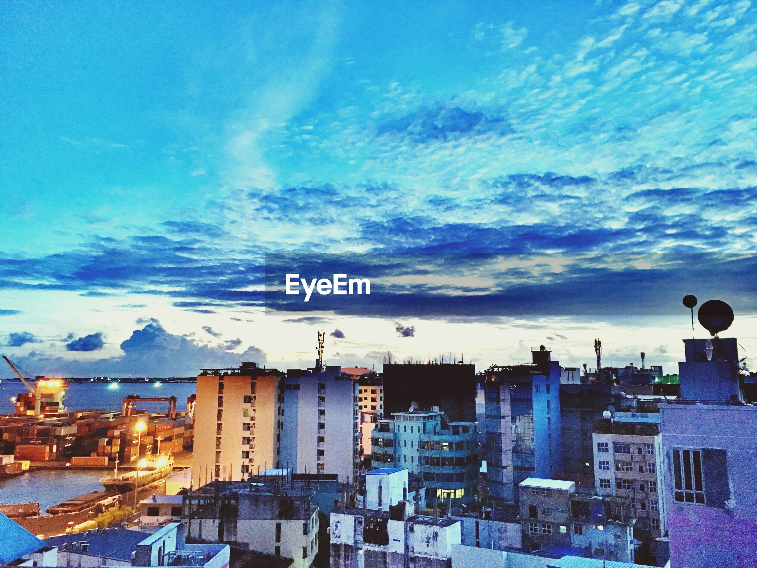 building exterior, sky, architecture, built structure, cloud - sky, city, blue, cloud, cityscape, outdoors, day, sea, water, no people, nature, incidental people, residential structure, residential building, cloudy, panoramic