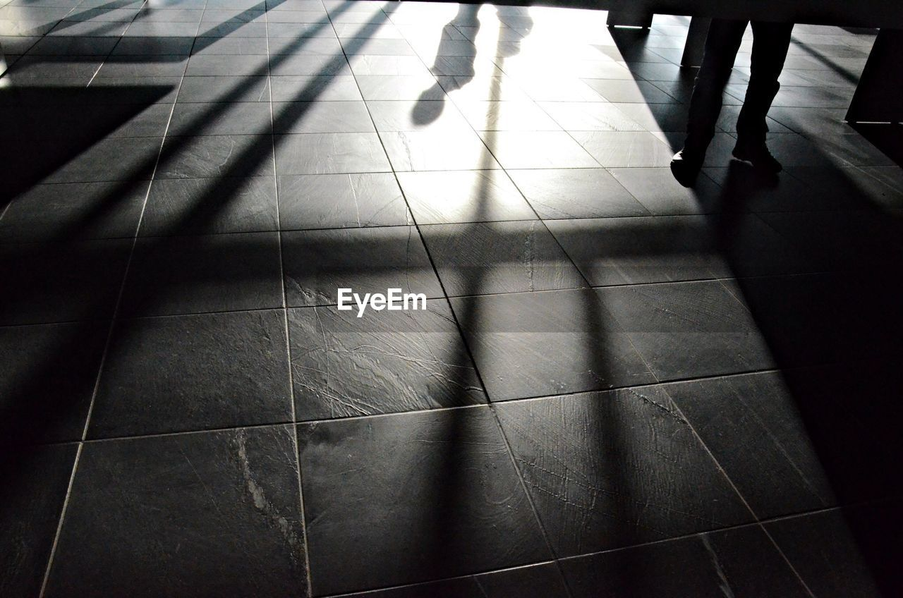 Shadow of person on floor