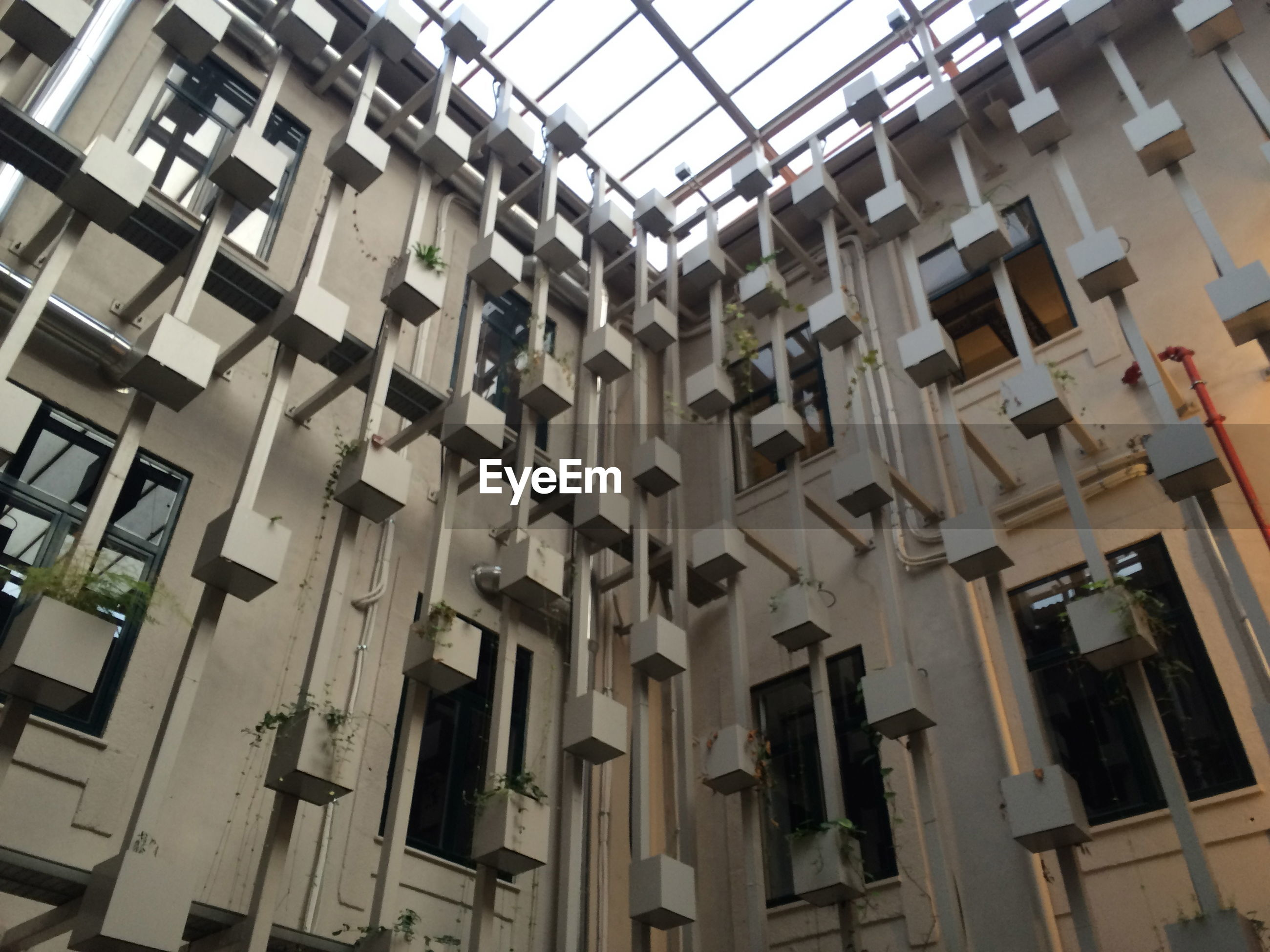 low angle view, architecture, building exterior, built structure, hanging, no people, day, outdoors, drying