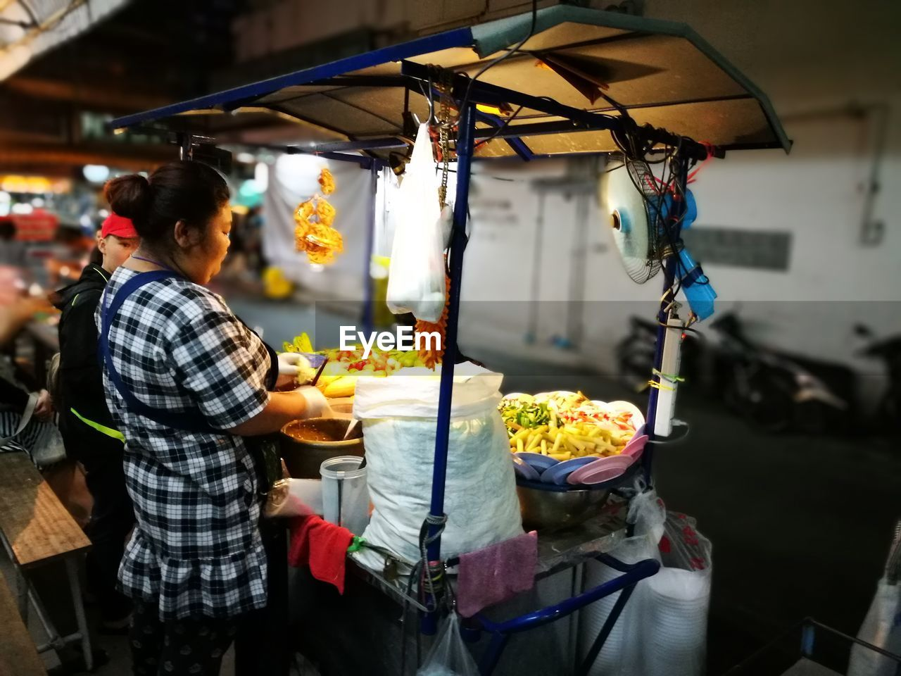 real people, food, food and drink, small business, market, market stall, freshness, retail, men, preparation, occupation, standing, healthy eating, one person, commercial kitchen, outdoors, night, ready-to-eat, people