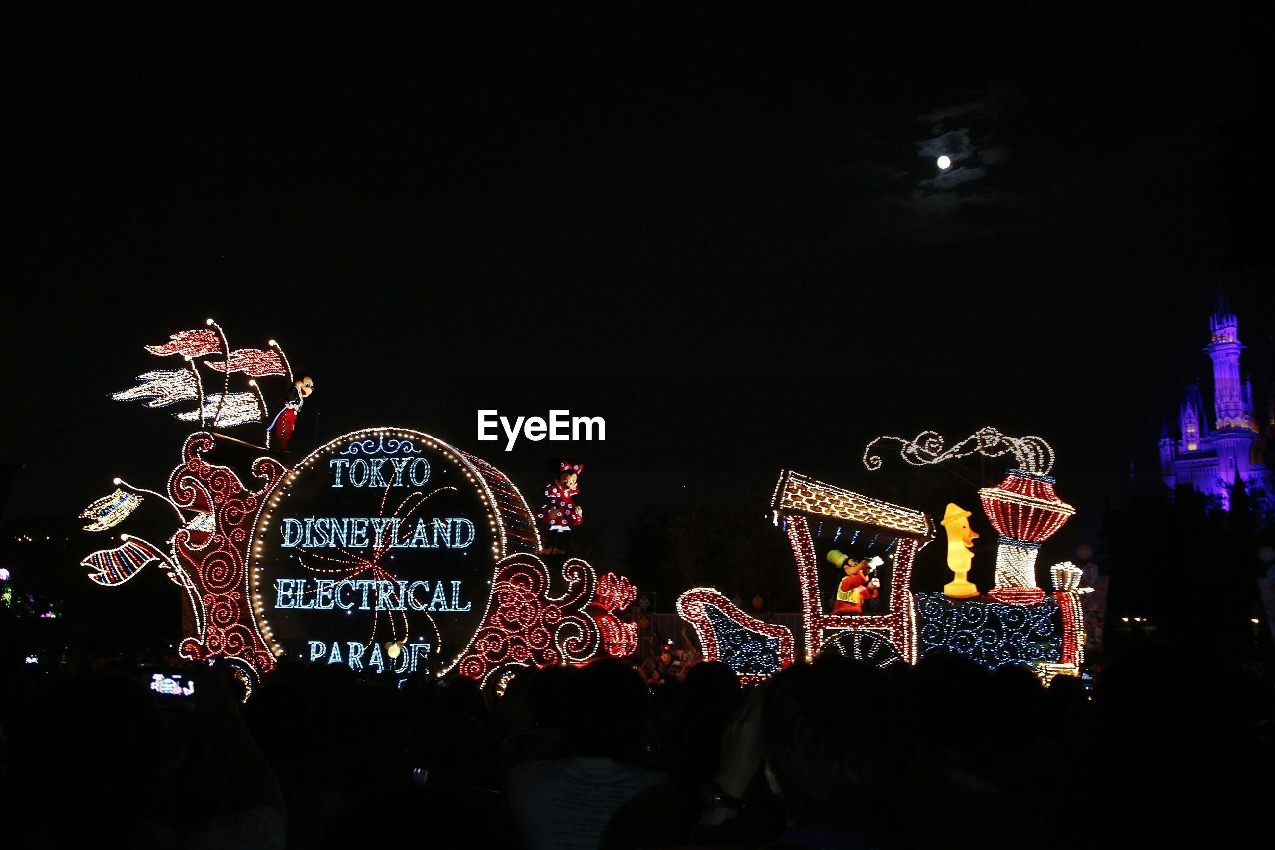 ILLUMINATED FERRIS WHEEL AT NIGHT DURING FESTIVAL