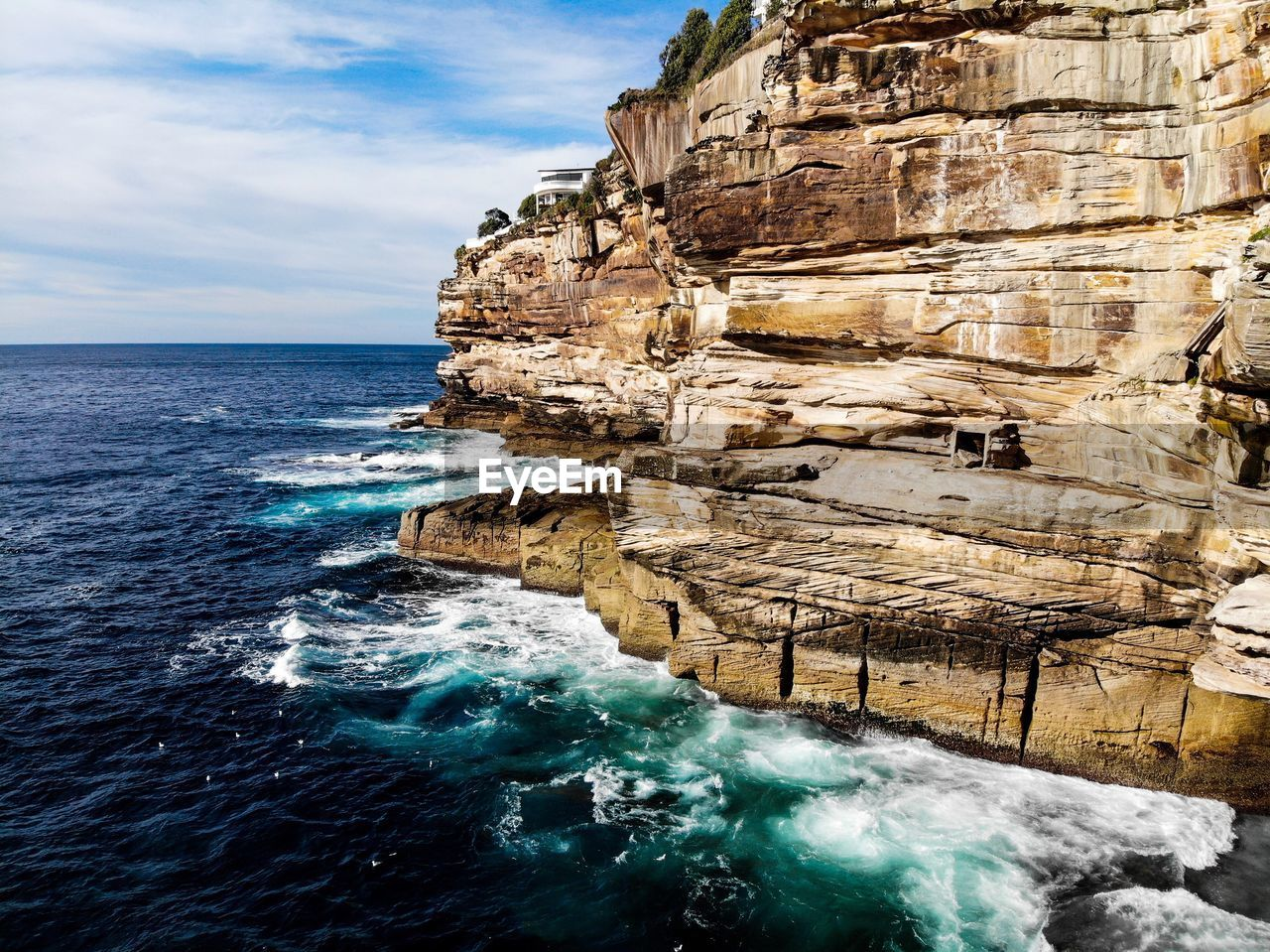 water, sea, sky, beauty in nature, scenics - nature, nature, rock, solid, rock formation, rock - object, day, motion, land, horizon over water, no people, cloud - sky, travel destinations, horizon, cliff, outdoors, eroded