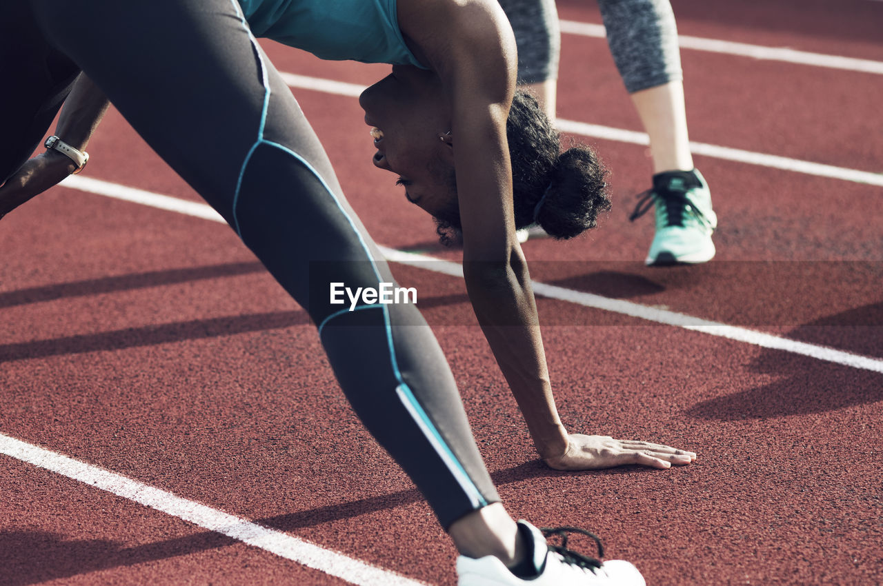 sport, competition, track and field, running track, real people, lifestyles, low section, athlete, competitive sport, running, human leg, human body part, track and field athlete, day, sports clothing, body part, shoe, sports track, sports race, people, outdoors, effort, human foot