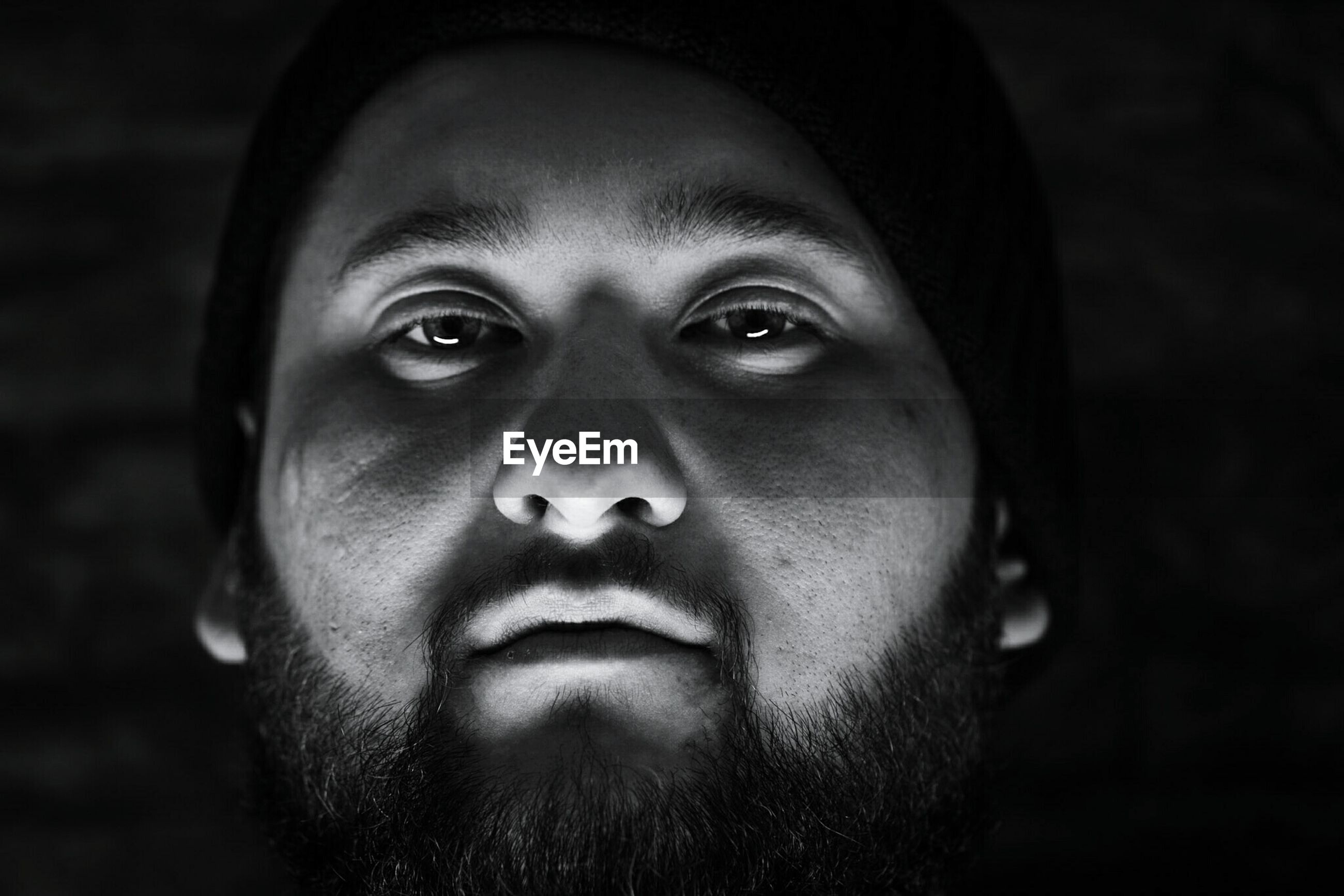 Close-up portrait of man in darkroom