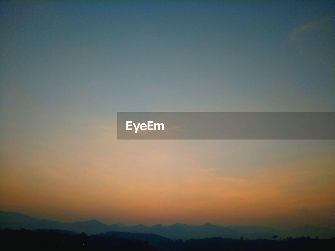 sky, sunset, beauty in nature, scenics - nature, tranquility, tranquil scene, cloud - sky, nature, no people, silhouette, idyllic, mountain, orange color, environment, sun, outdoors, landscape, copy space, sunlight, non-urban scene, romantic sky