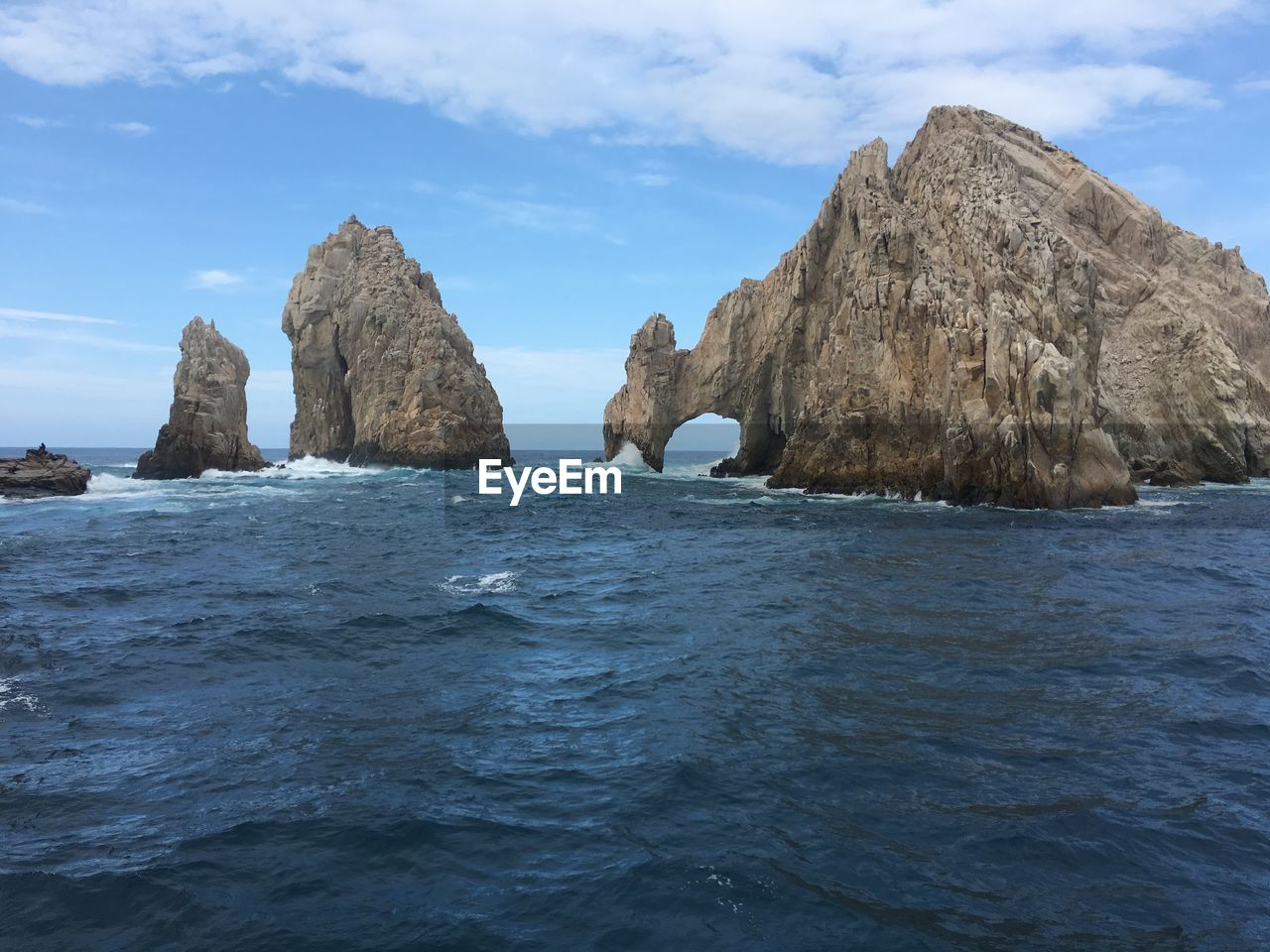 rock - object, sea, sky, nature, rock formation, tranquility, beauty in nature, scenics, tranquil scene, water, day, outdoors, cloud - sky, no people, iceberg
