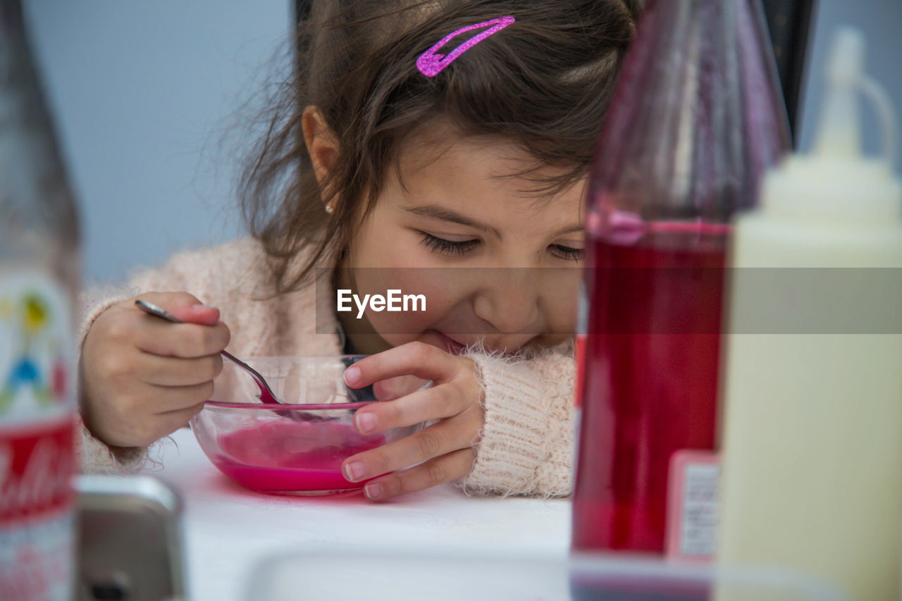 Close-up of small girl enjoying soup