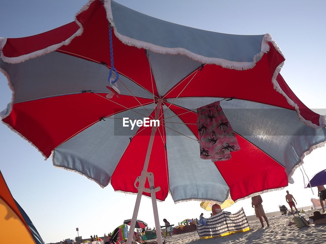 Low Angle View Of Parasol At Beach Against Sky