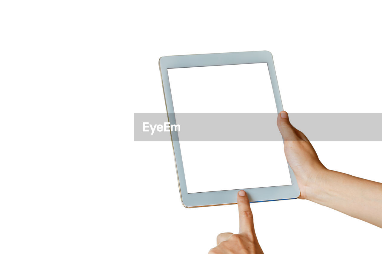 Low angle view of hand holding digital tablet against white background