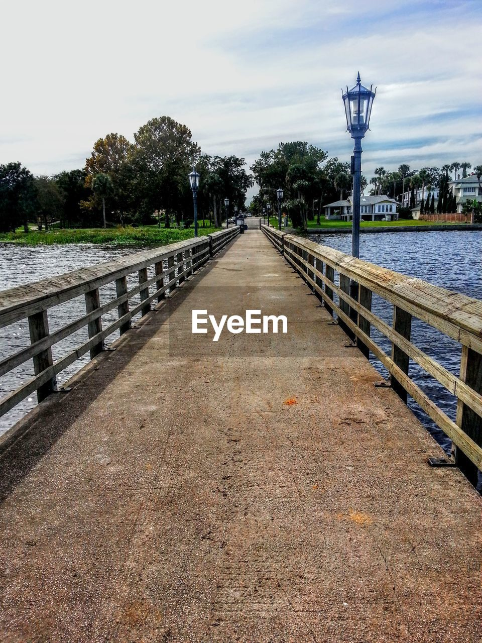 sky, the way forward, direction, nature, water, diminishing perspective, railing, plant, transportation, no people, built structure, tree, day, connection, architecture, cloud - sky, vanishing point, footpath, outdoors, long