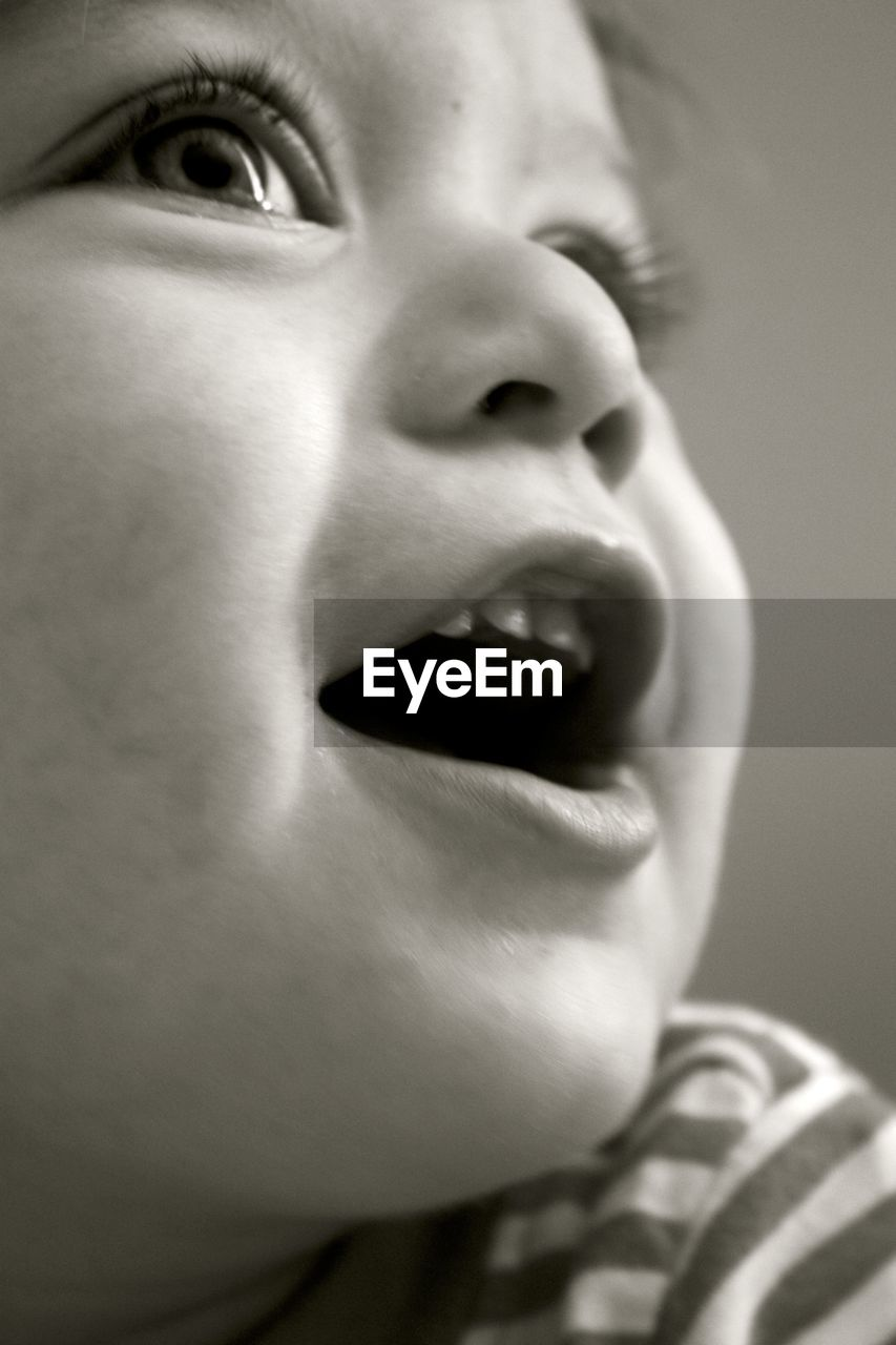 real people, human face, one person, childhood, close-up, boys, indoors, human body part, elementary age, human eye, human lips, day