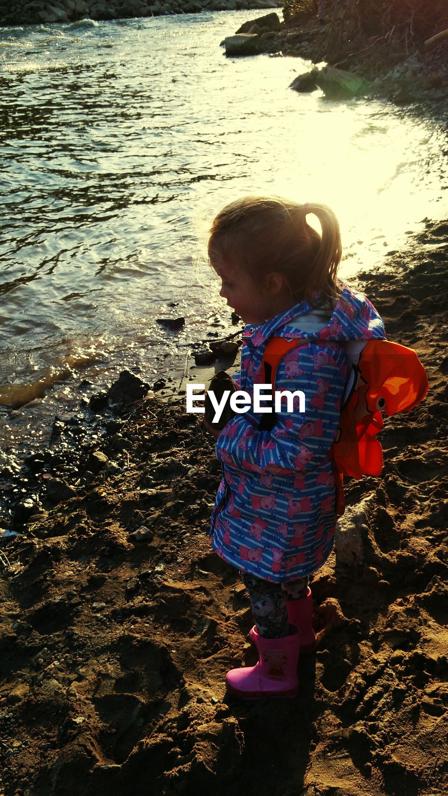High angle view of girl playing by lake