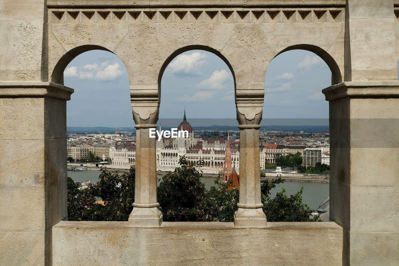 Hungarian Parliament Building Seen Through Arch Window