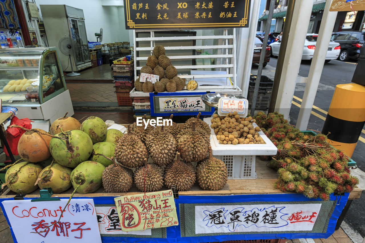 food, food and drink, choice, healthy eating, variation, freshness, wellbeing, retail, text, market, large group of objects, fruit, for sale, market stall, business, communication, no people, script, price tag, non-western script, retail display, sale