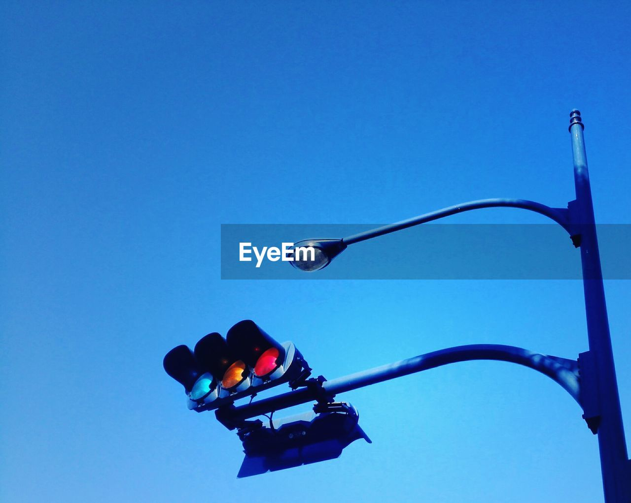 blue, sky, clear sky, copy space, low angle view, nature, light, lighting equipment, no people, street light, day, stoplight, road signal, outdoors, street, red light, electric light, illuminated, sign, transportation