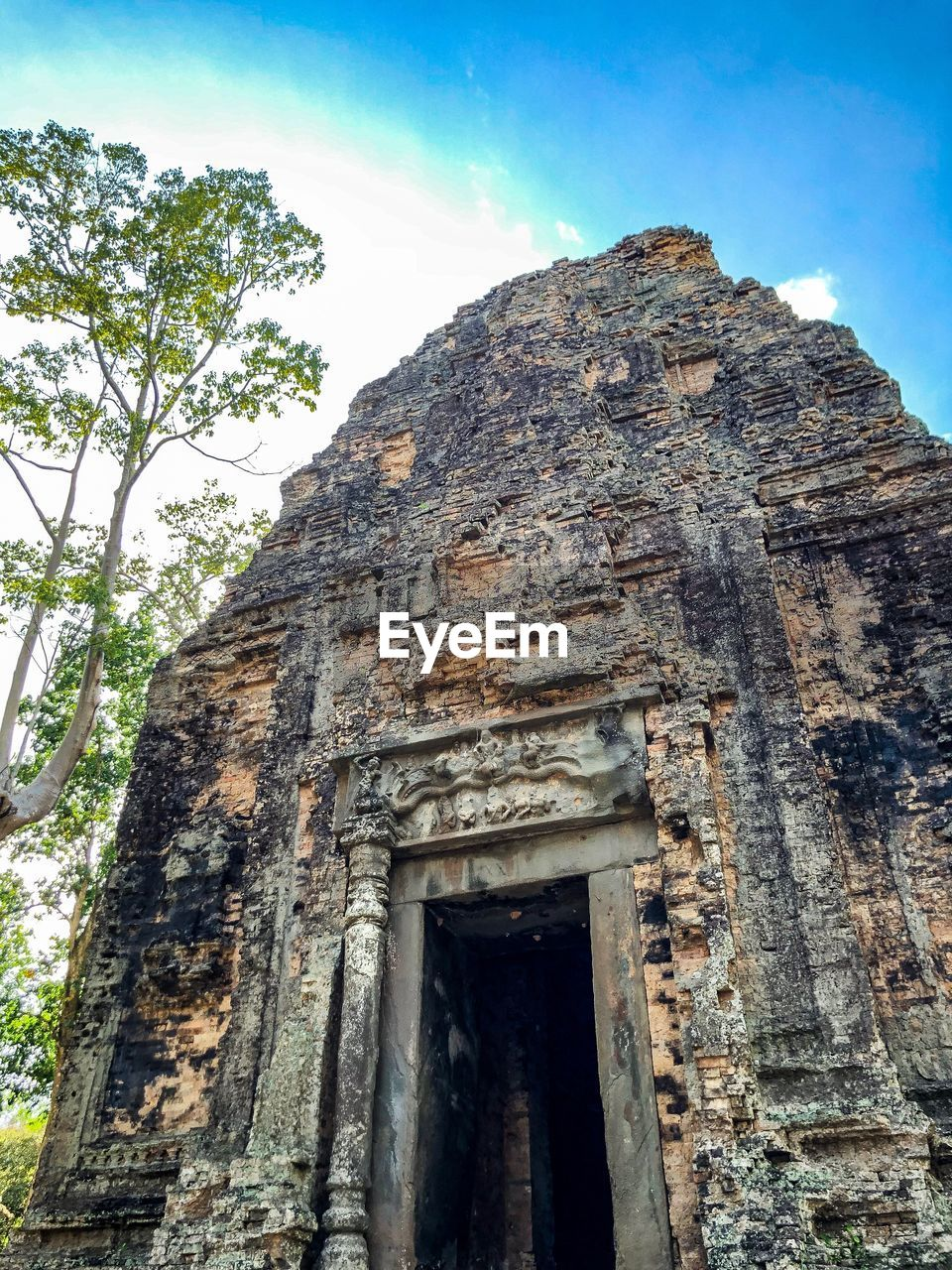 architecture, built structure, low angle view, history, sky, the past, building, old, ancient, no people, building exterior, day, weathered, belief, ancient civilization, old ruin, place of worship, religion, nature, tree, outdoors, archaeology, deterioration, ruined