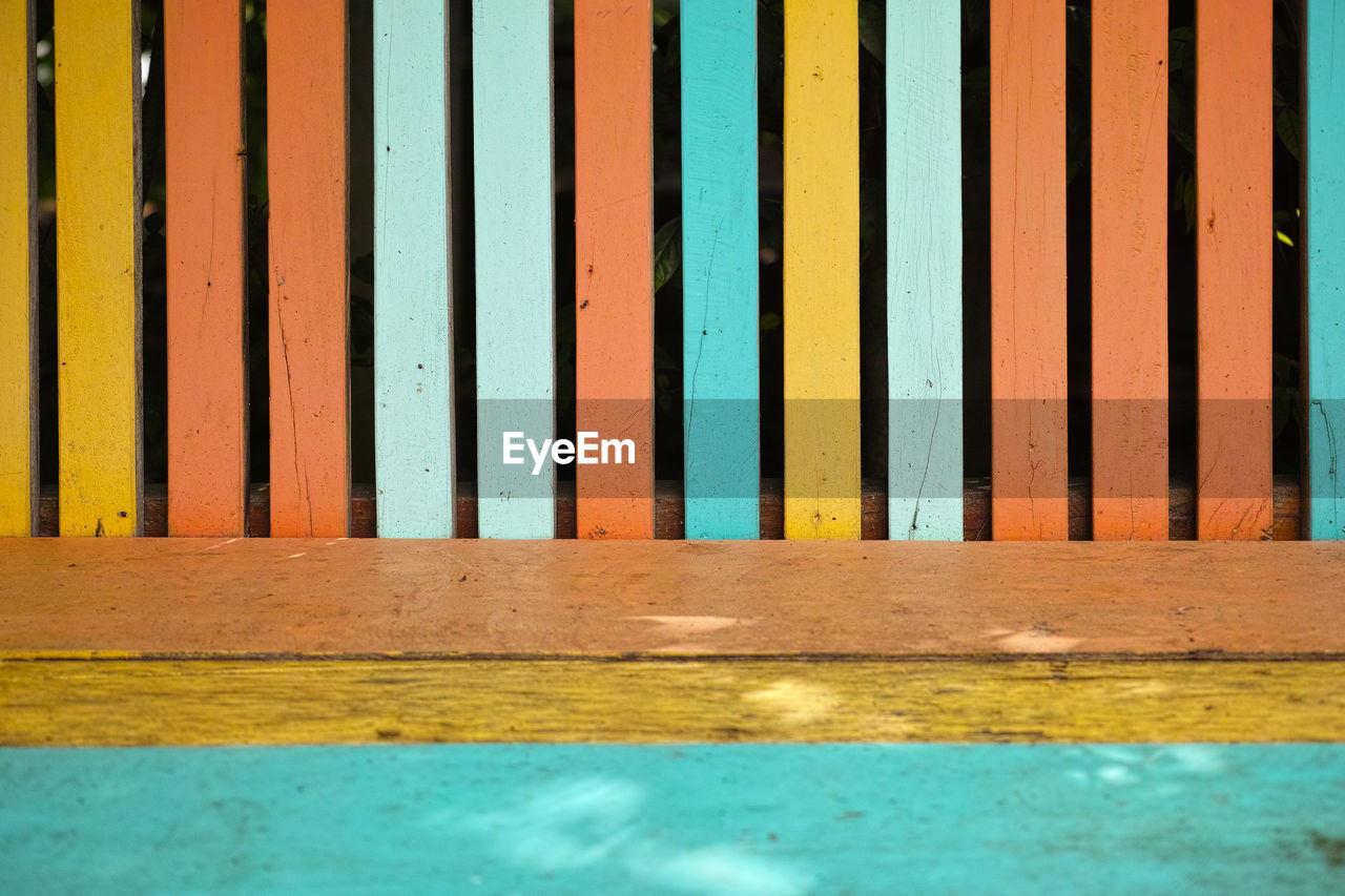 no people, pattern, day, wood - material, full frame, architecture, backgrounds, built structure, blue, wall - building feature, reflection, striped, water, yellow, close-up, outdoors, textured, swimming pool, multi colored