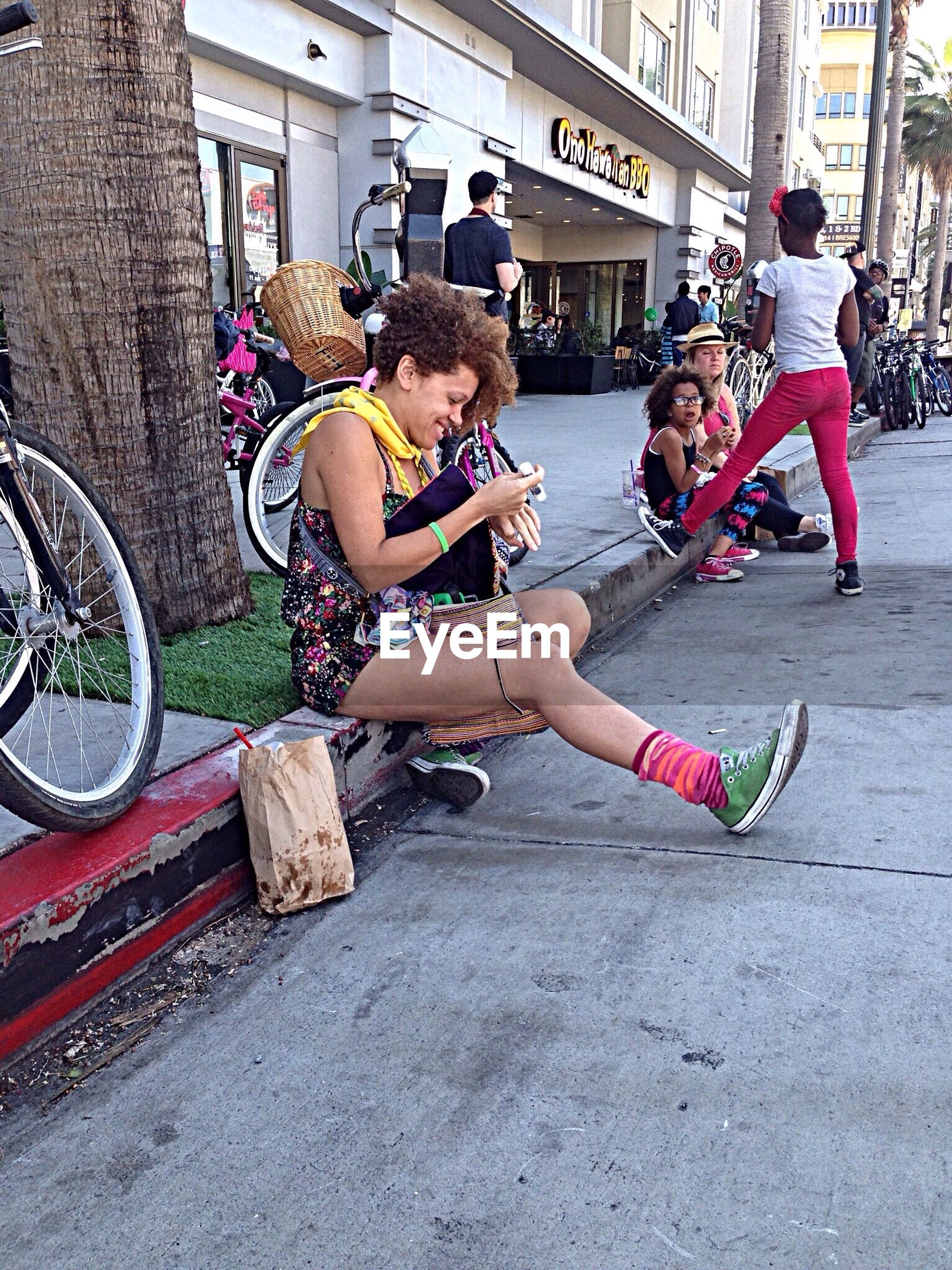 lifestyles, leisure activity, full length, sitting, casual clothing, land vehicle, person, childhood, mode of transport, togetherness, bicycle, girls, street, transportation, men, boys, elementary age