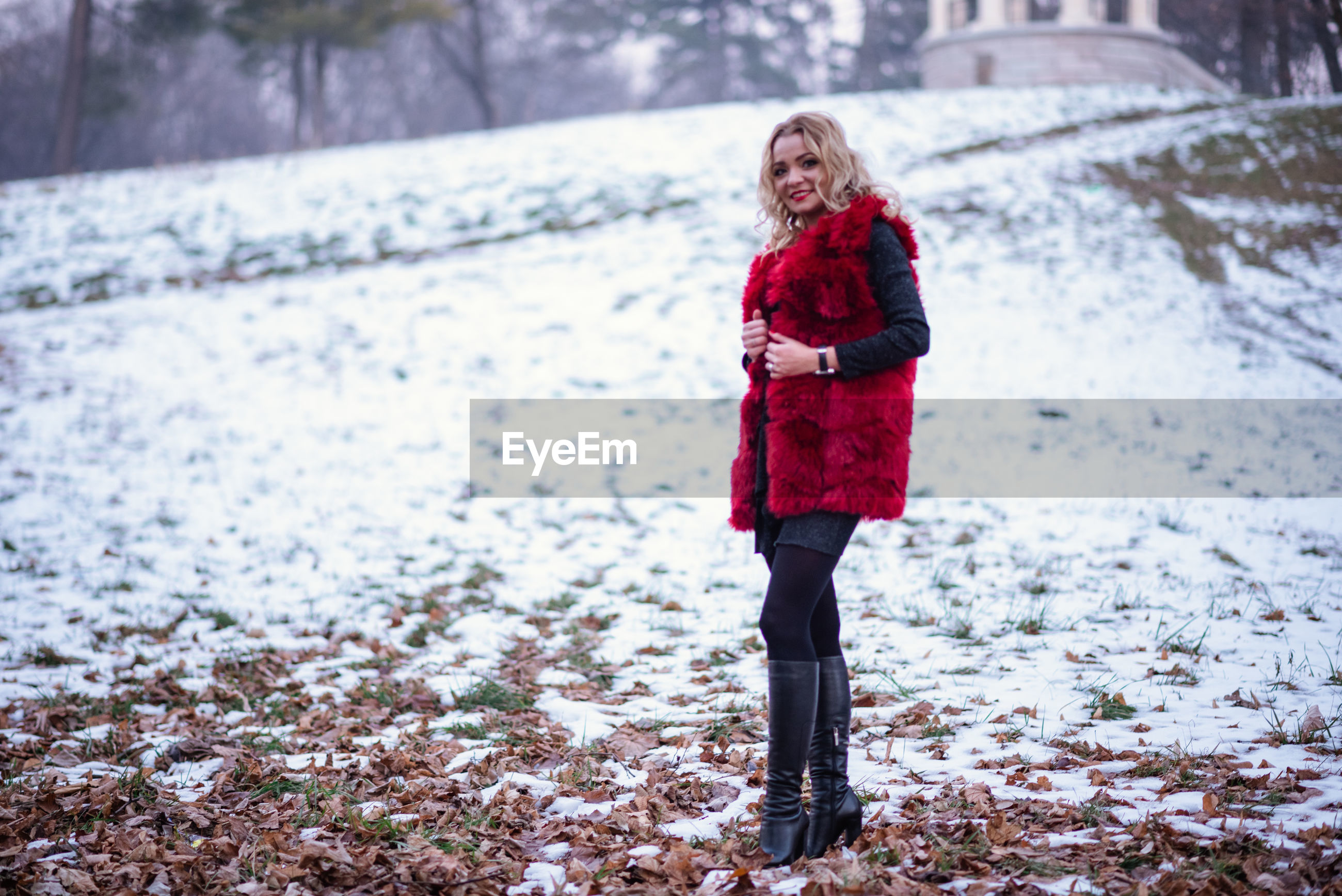 Full length of woman on snow covered land