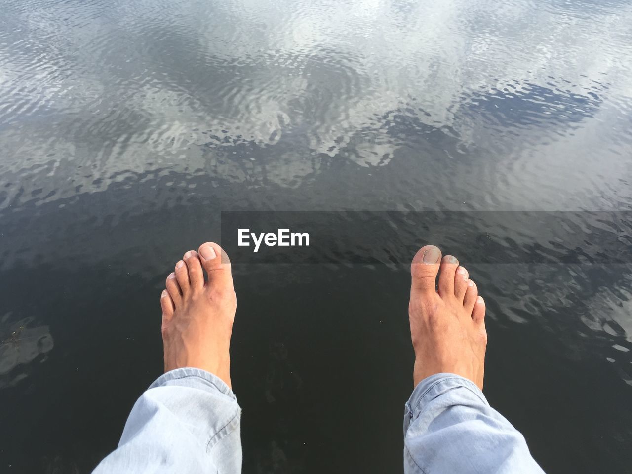 water, low section, barefoot, personal perspective, human leg, real people, one person, human foot, day, human body part, leisure activity, lake, men, reflection, outdoors, lifestyles, nature, close-up