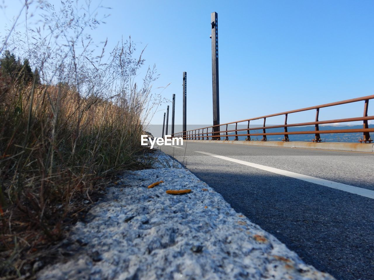 transportation, sky, road, clear sky, nature, no people, built structure, architecture, connection, day, direction, the way forward, plant, bridge, bridge - man made structure, outdoors, railing, diminishing perspective, tree, sunlight, surface level
