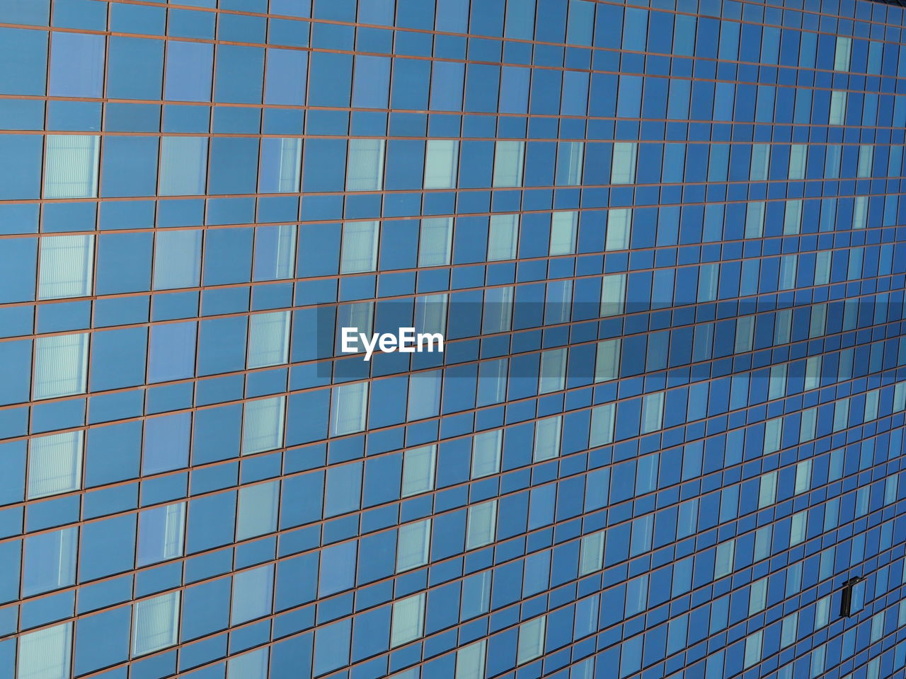 full frame, backgrounds, architecture, pattern, window, no people, blue, low angle view, built structure, day, building exterior, outdoors, modern, clear sky, sky, close-up
