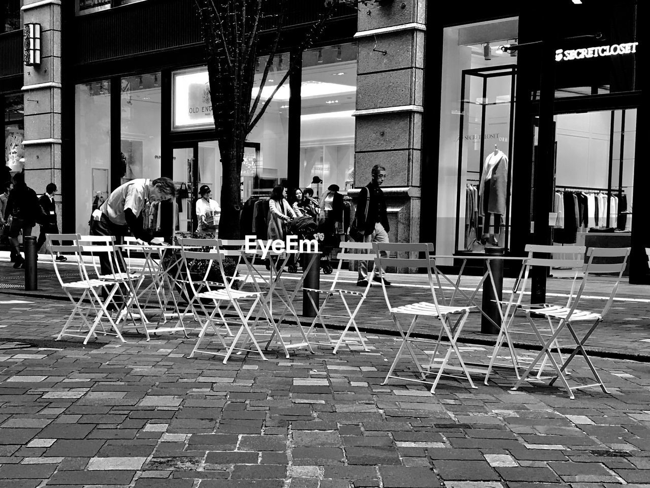 PEOPLE SITTING ON CHAIRS AT CAFE
