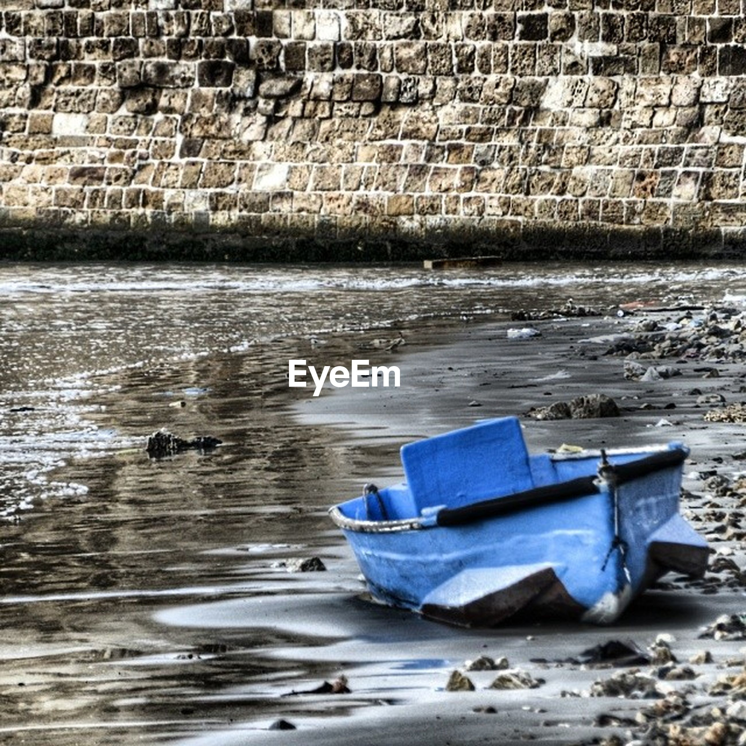 water, boat, abandoned, nautical vessel, transportation, moored, built structure, mode of transport, building exterior, damaged, architecture, day, obsolete, beach, outdoors, shore, old, no people, high angle view, rock - object