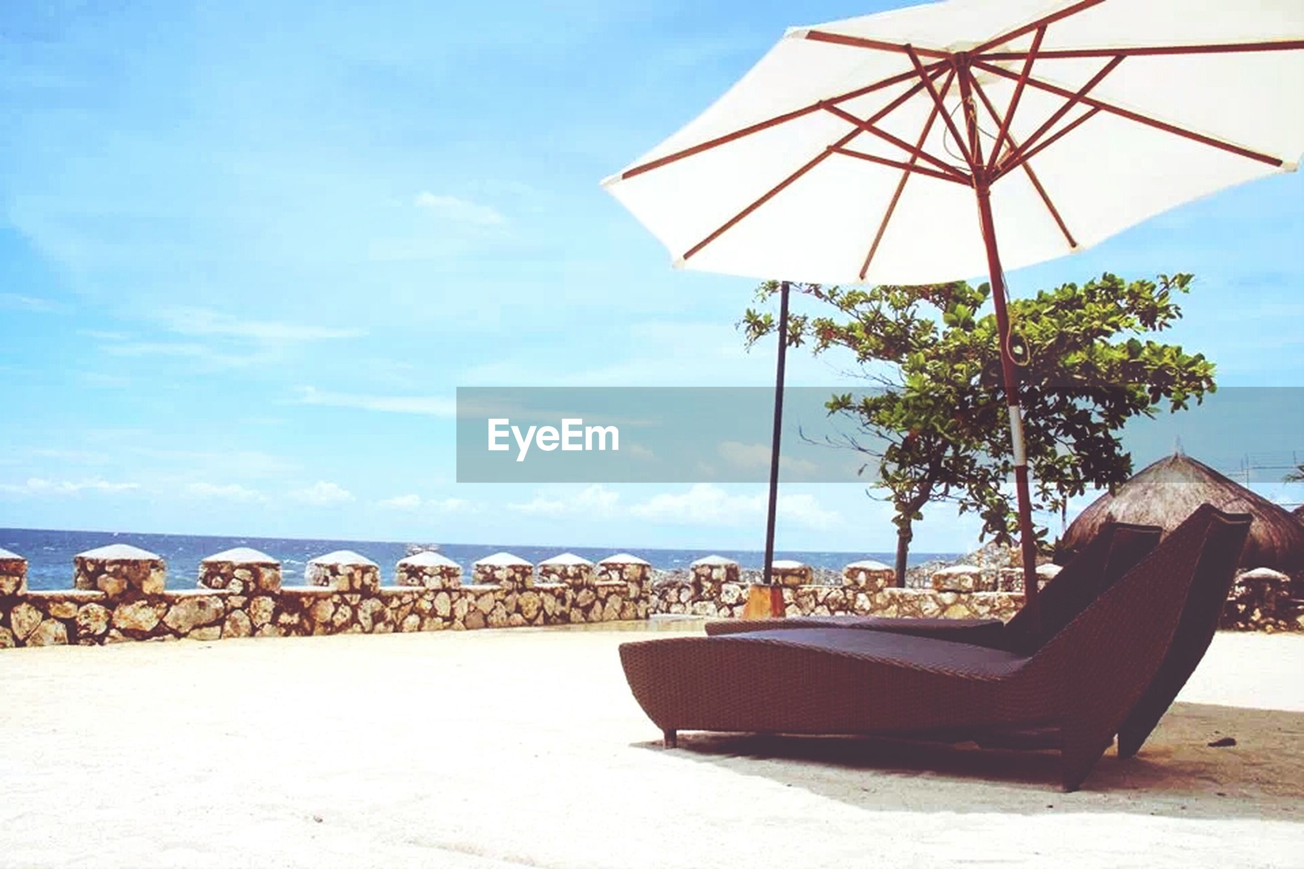 beach, sea, sand, beach umbrella, sky, horizon over water, sunshade, parasol, shore, lounge chair, thatched roof, water, summer, chair, vacations, absence, tranquility, tranquil scene, sunlight, built structure