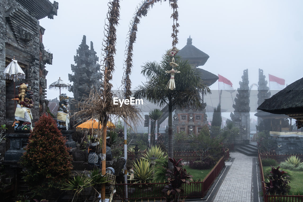 The Pura Ulun Danu Batur Balinese Hinduism temple on a foggy day in Kintamani in Bali, Indonesia ASIA Bali Balinese INDONESIA Indonesian Kintamani Pura Pura Ulun Danu Batur Ancient Atmospheric Mood Building Culture Exterior Fog Hindu Hinduism Monument Moody Mountain Nobody Old Religion Stone Temple Tourism Traditional Travel Travel Destinations Architecture Built Structure