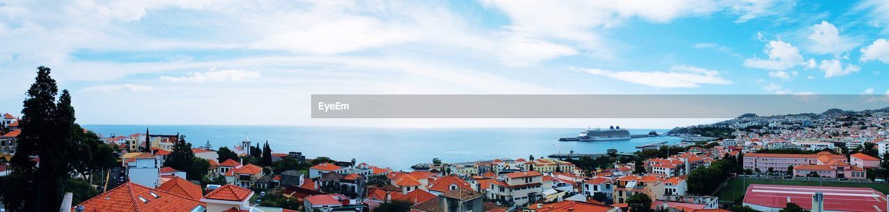 sky, water, cloud - sky, sea, architecture, building exterior, horizon over water, built structure, horizon, nature, city, day, residential district, high angle view, building, beauty in nature, panoramic, scenics - nature, no people, outdoors, townscape