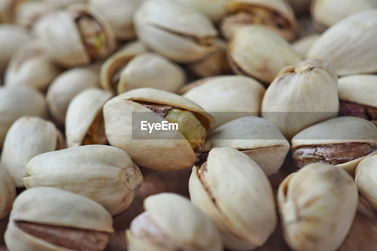 food and drink, food, large group of objects, wellbeing, freshness, healthy eating, still life, full frame, close-up, backgrounds, abundance, no people, selective focus, indoors, pistachio, heap, nut, retail, for sale, market