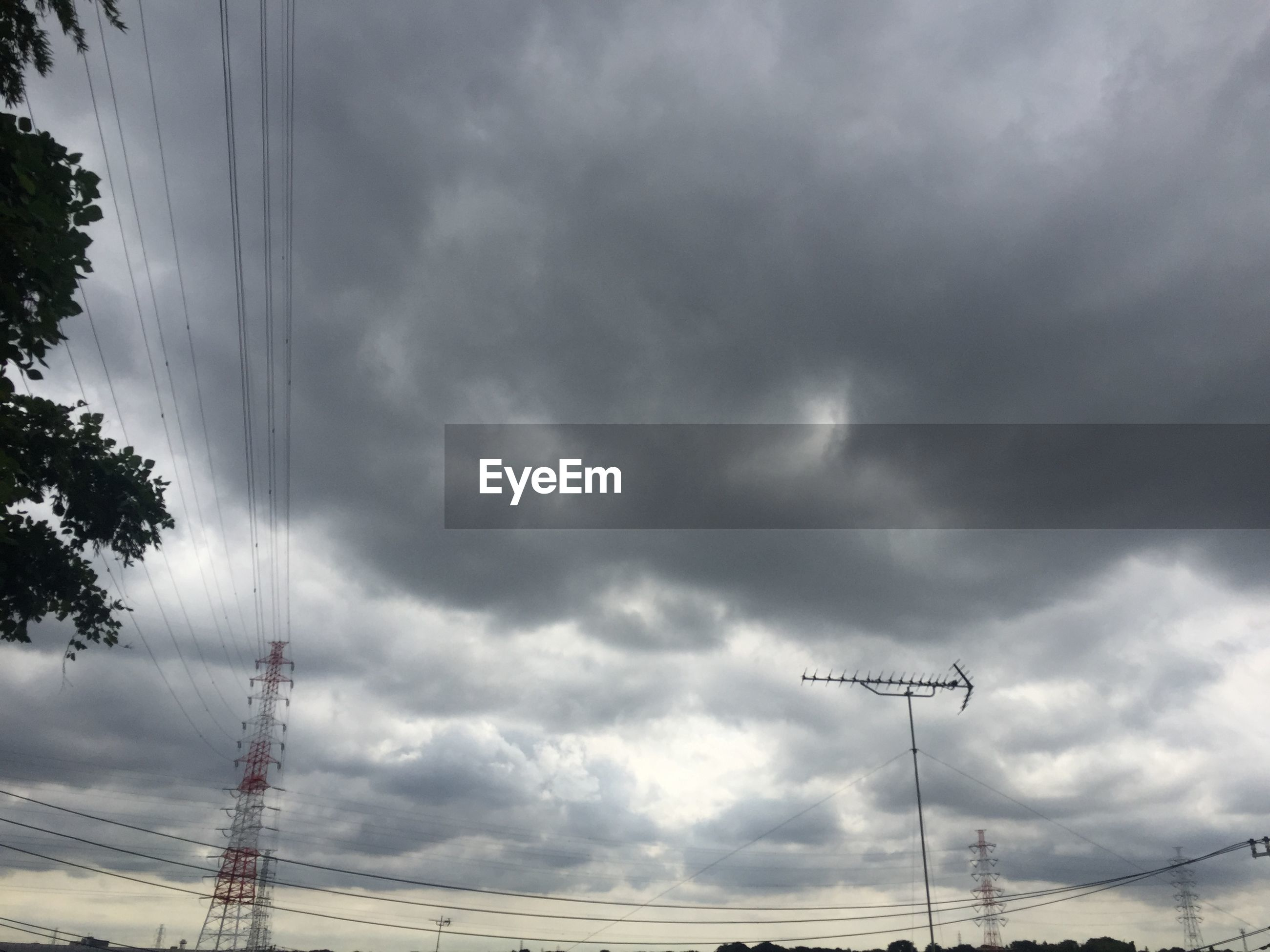 power line, sky, electricity, cloud - sky, electricity pylon, low angle view, cable, cloudy, power supply, connection, weather, tree, technology, fuel and power generation, tranquility, nature, scenics, cloud, overhead cable car, transportation