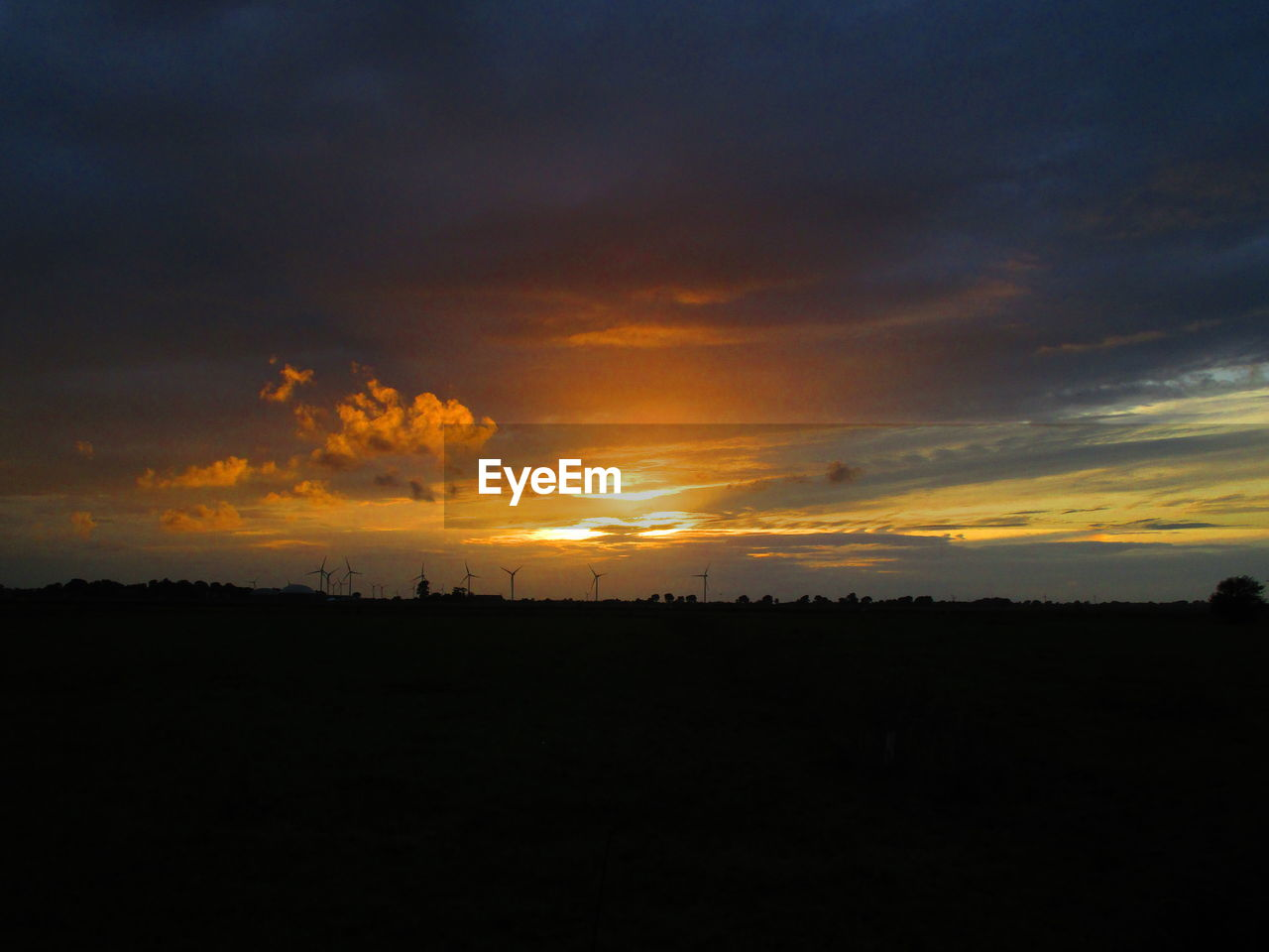 sky, sunset, beauty in nature, scenics - nature, silhouette, tranquil scene, tranquility, cloud - sky, orange color, non-urban scene, landscape, idyllic, environment, nature, no people, outdoors, land, field, copy space, dramatic sky