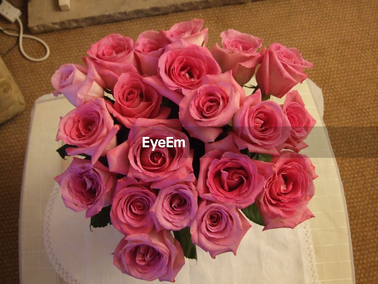 flower, rose - flower, pink color, petal, fragility, indoors, no people, high angle view, freshness, flower head, bouquet, table, close-up, nature, beauty in nature, day, florist