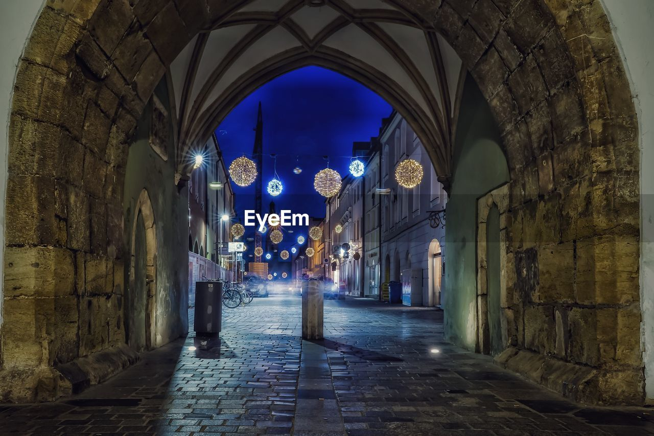 architecture, arch, built structure, building, illuminated, night, building exterior, the way forward, direction, city, history, the past, lighting equipment, no people, religion, spirituality, belief, street, place of worship, architectural column