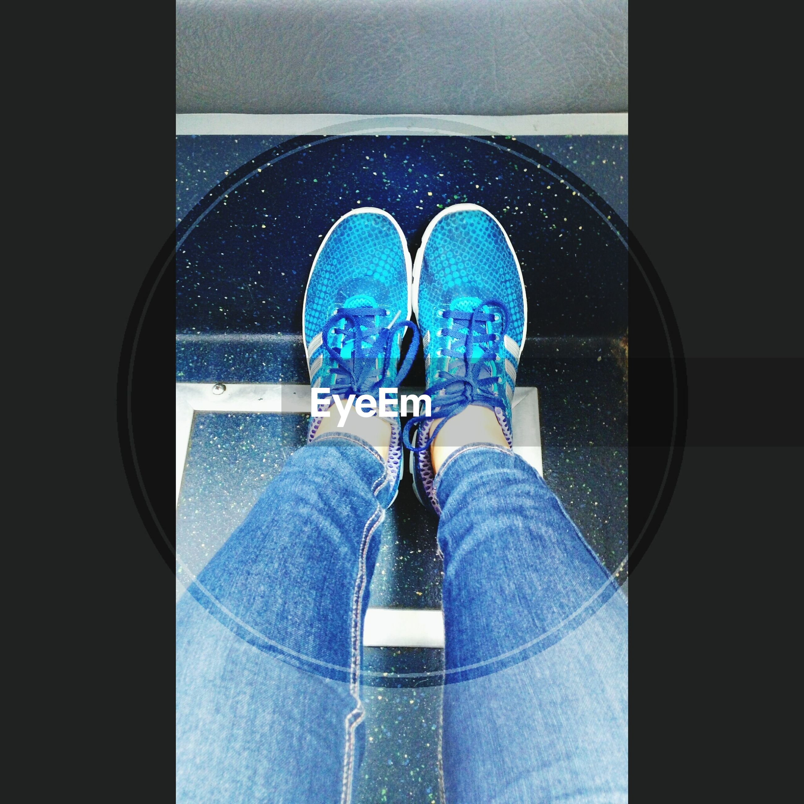 indoors, blue, lifestyles, low section, person, leisure activity, standing, shoe, casual clothing, men, rear view, sitting, jeans, personal perspective, close-up, day