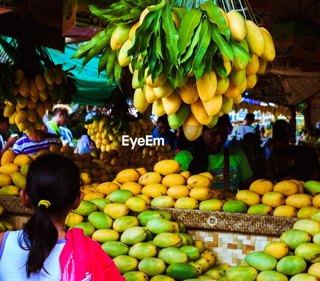 Rear View Of Fruit For Sale At Market Stall