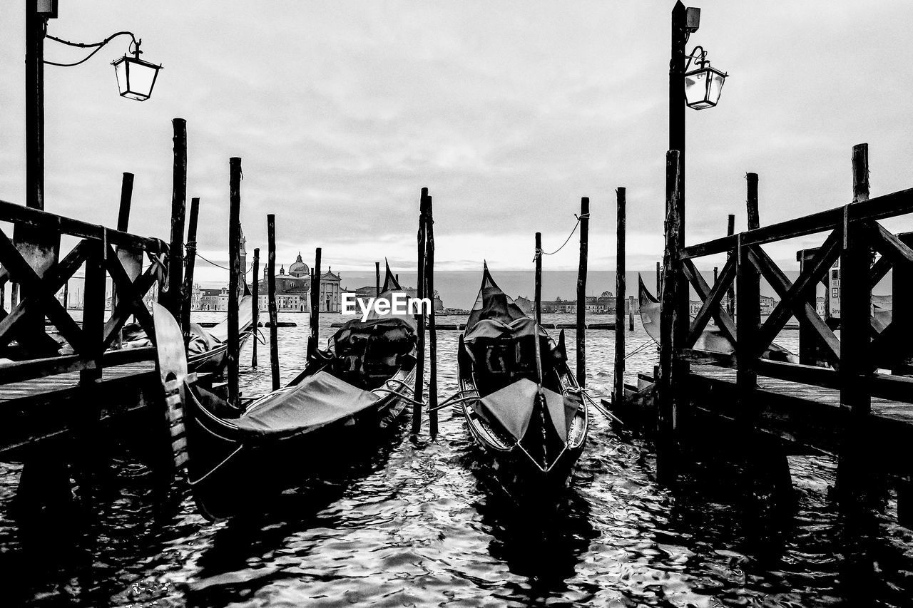 transportation, water, nautical vessel, mode of transportation, gondola - traditional boat, wooden post, post, waterfront, moored, sky, nature, no people, architecture, wood - material, travel destinations, day, built structure, travel, outdoors, canal