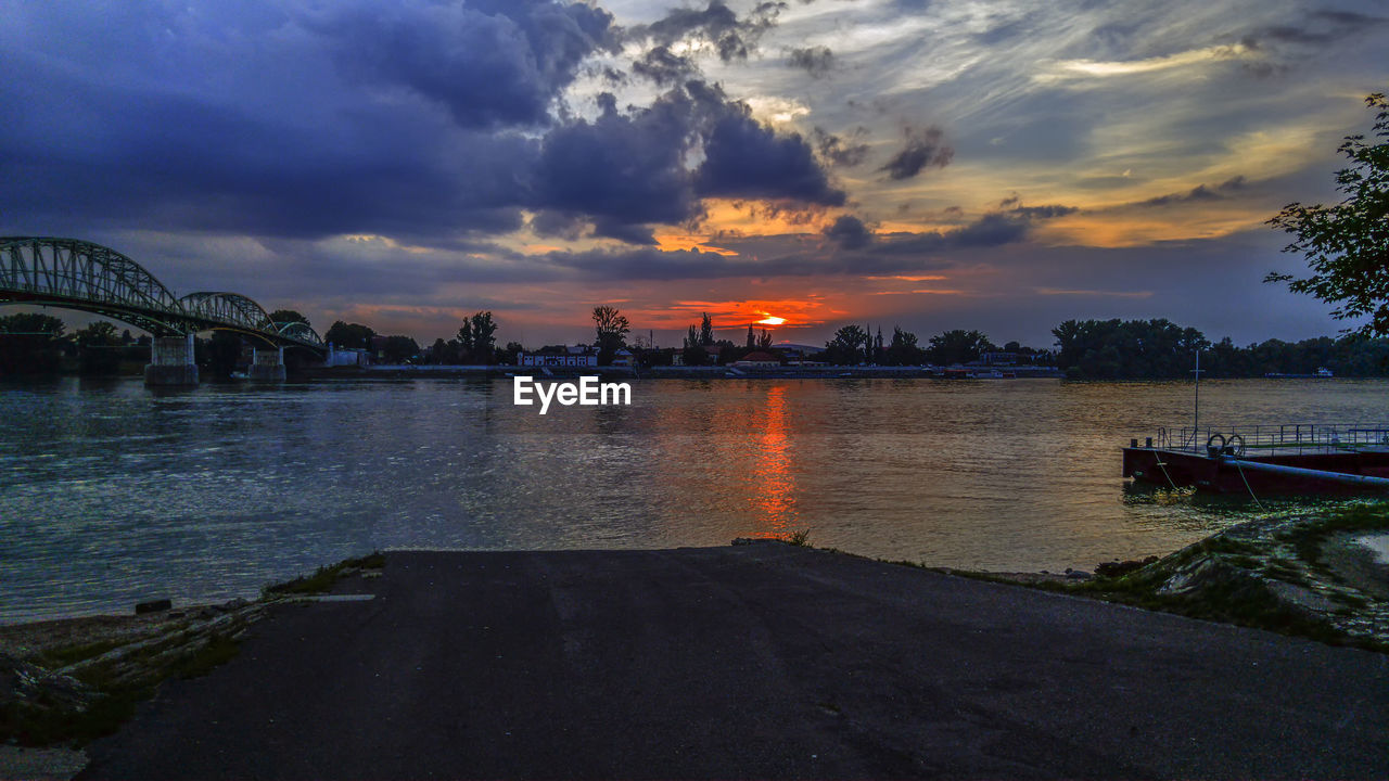 water, sky, cloud - sky, sunset, architecture, nature, built structure, beauty in nature, transportation, orange color, scenics - nature, river, nautical vessel, no people, outdoors, tranquility, city, connection, building exterior